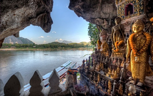 Buddha cave next to Mekong River