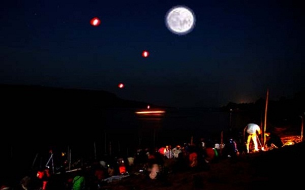 Thousands of locals and foreign visitors turn up to witness the rising of the Naga fireballs