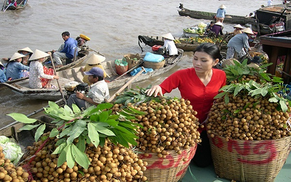 Floating market – a tourist attraction in a Mekong Delta river cruise