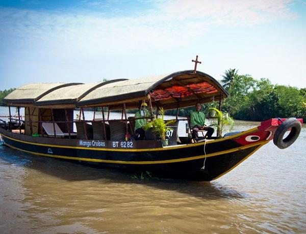 Taking a boat trip on Mekong River to Phoenix Island