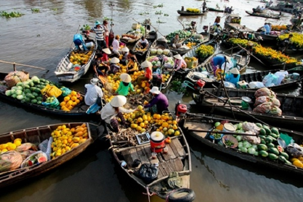Trading from boats brings excitement to buyers when catching some goods thrown from other boats.