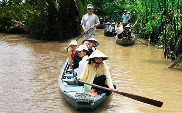 You can travel on the boat ride into the narrow shady waterways to see some more of the real life of the Mekong people
