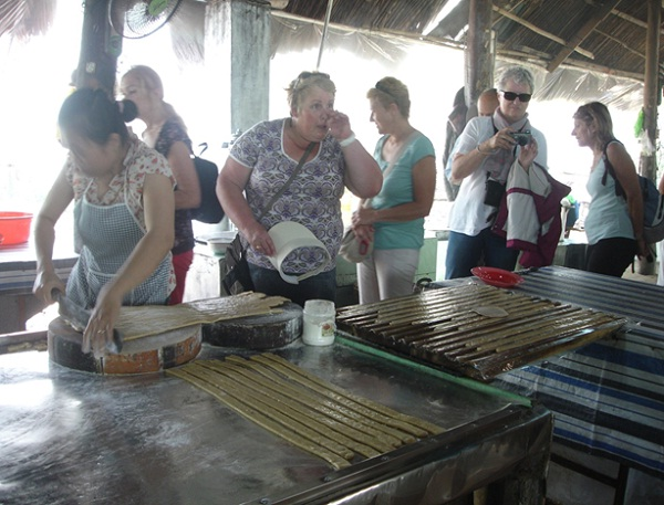 You will witness local families making coconut candies in Ben Tre