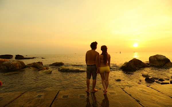 A Newly married honeymoon couple is relaxing on poetic beach, Phu Quoc