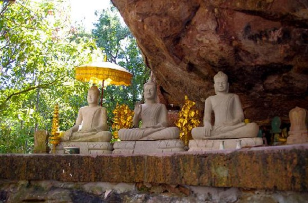 Buddha statues carved into sandstone