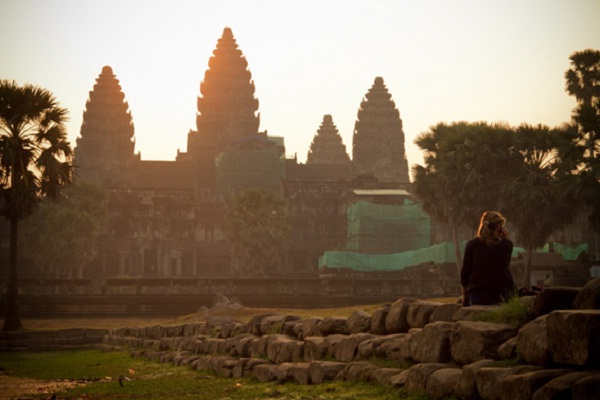 Tourists are watching sunrise at Angkor Wat
