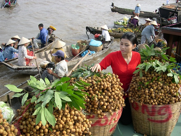 Full baskets of fruits are on sale every morning in Mekong Delta's floating markets