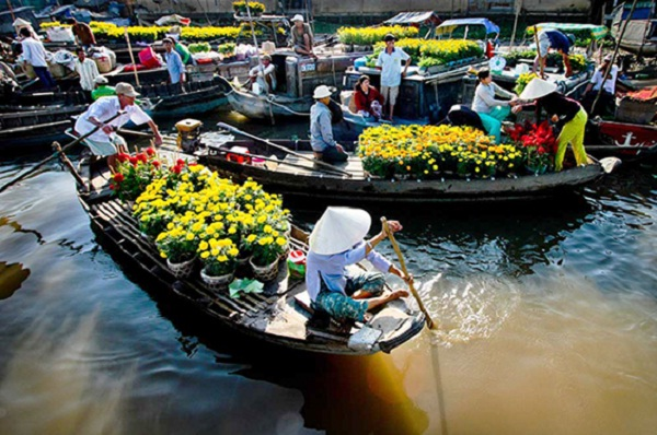 The colorful floating market in Tet holiday