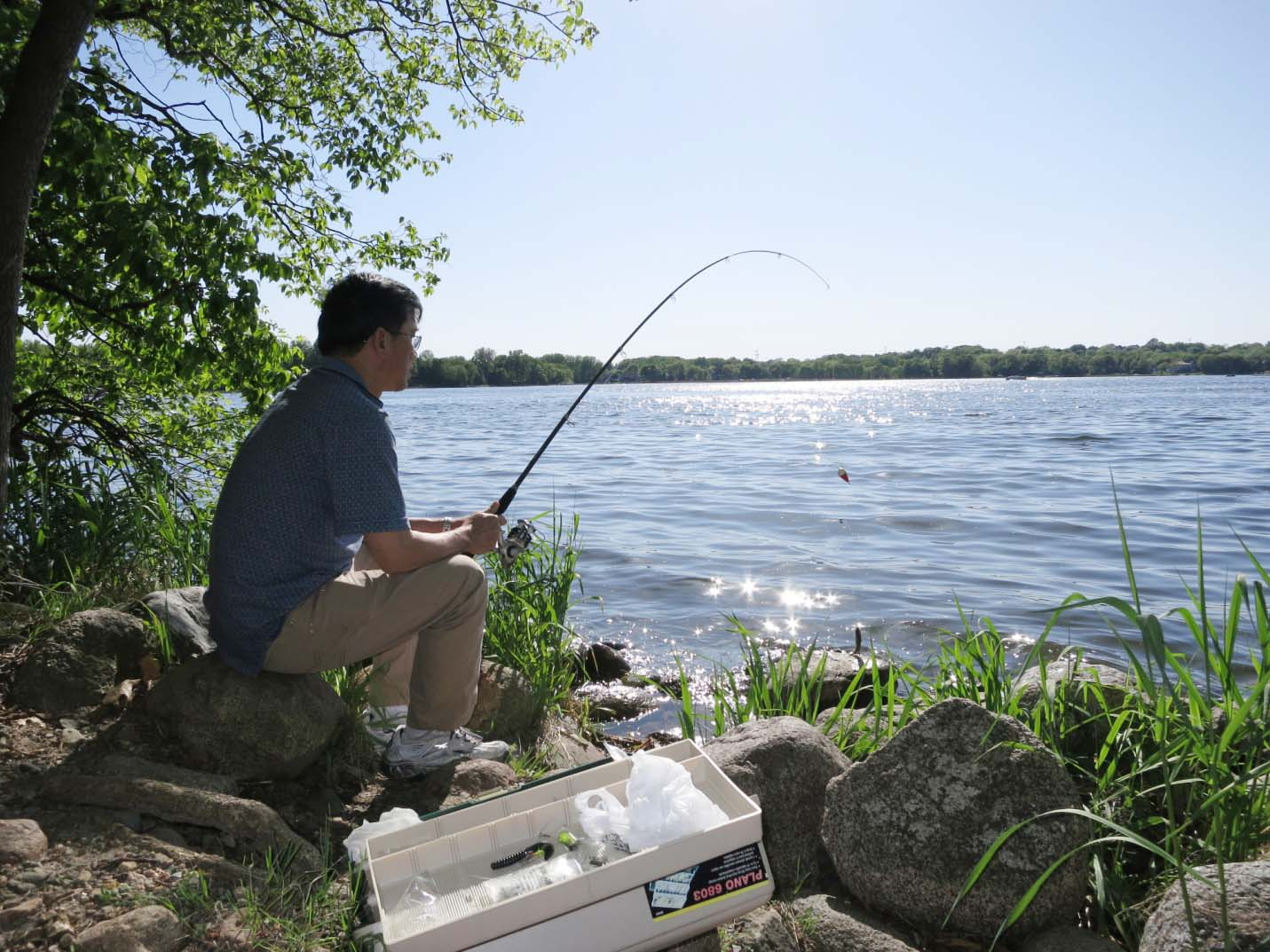 Fisher is waiting for black carps patiently