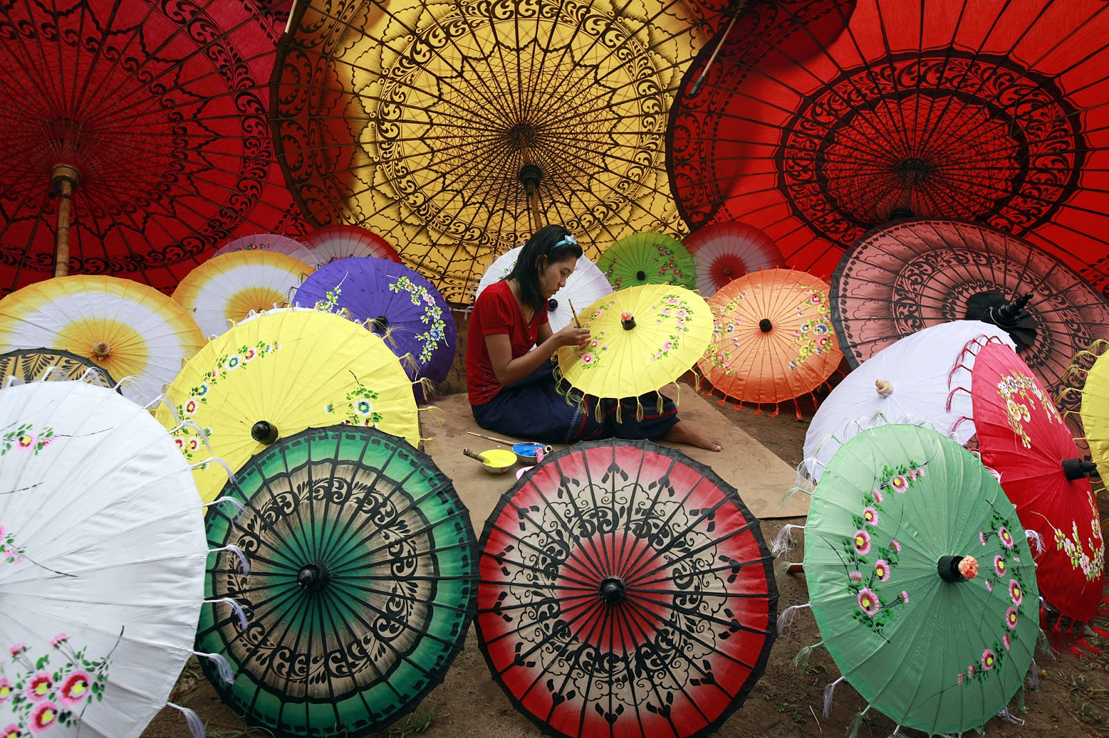 Some traditional umbrellas in Myanmar which you can buy as the presents