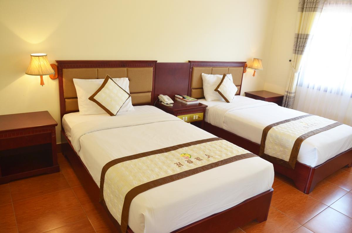 The warm bedroom in Hoian Silk Marina Resort and Spa