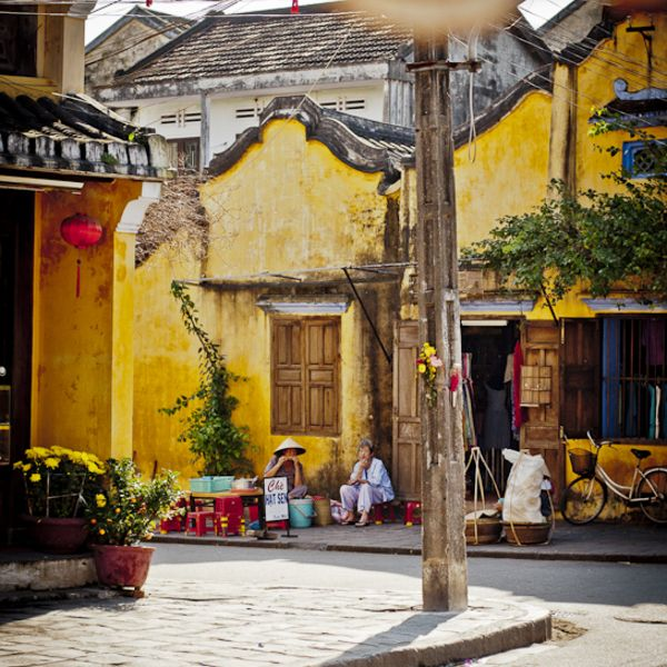 The beauty of Hoian in the April is lightened up with wooden houses on narrow street