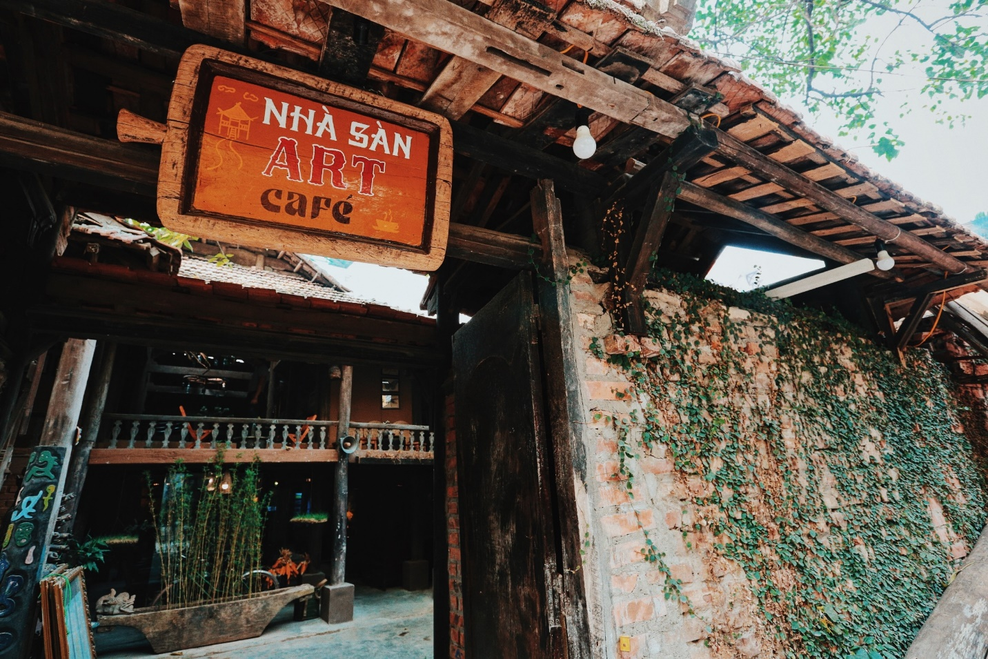 The gate of Nha San Cafe will impress you so much