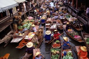 Small canal with full of boats on Damnoen Saduak floating market