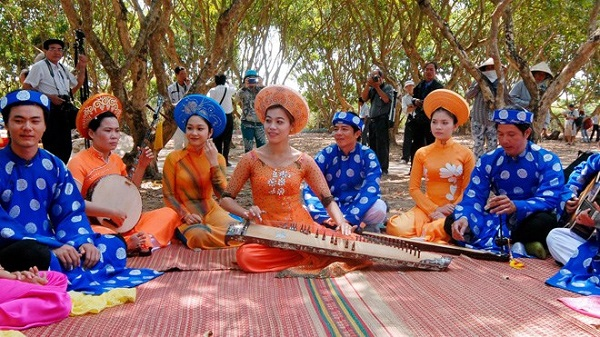 Local people perform traditional music in their fruit farm