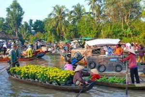 Passing buy floating market and buy some products from the local people