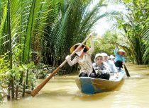 Tourists on a small boat weaving its way on small waterways