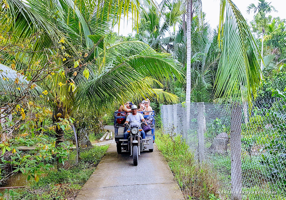 riding a motor cart- xe loi or bike on shady paths